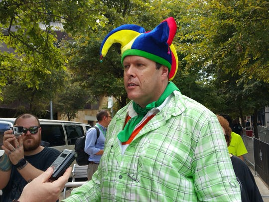 Controversial Travis County GOP Chairman Rob Morrow turned out to a Trump event in Austin Tuesday to accuse the Republican presidential nominee of being a criminal. Morrow said he plans to write himself in when he votes for president.