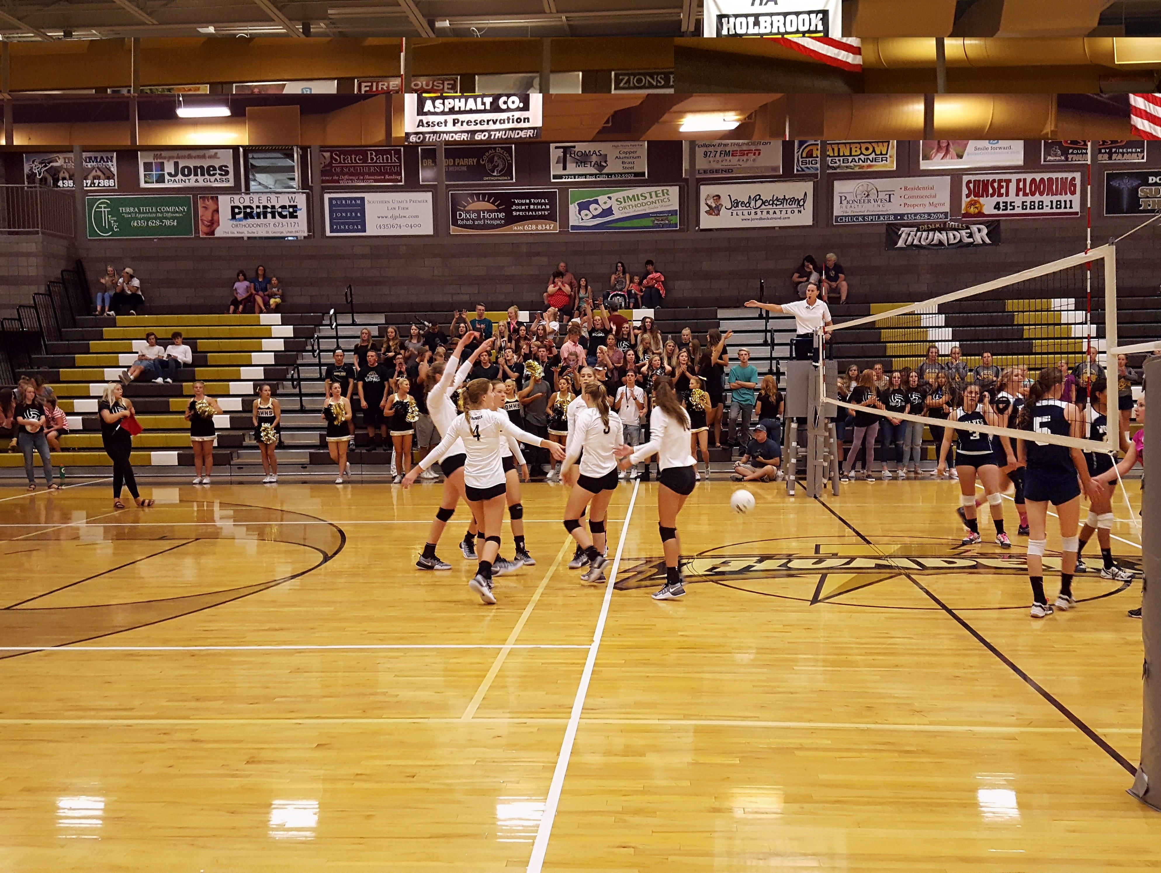 Desert Hills celebrates winning a point Thursday, August 25, 2016