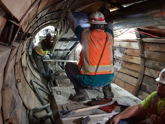 Crew members work inside the tunnel that will carry Michigan Ditch water to Joe Wright Reservoir. The tunnel-boring portion of the project is nearing completion.