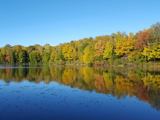 Fall colors line Porcupine Lake along the North Country