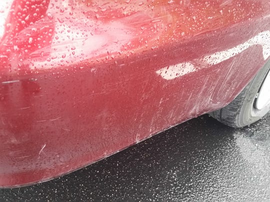 "Police photo of scrapes on Francis ""Julien"" Anastasia's vehicle."