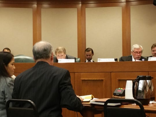 Officials with the Texas Ethics Commission testify at a Texas Senate State Affairs Committee hearing last year. They discussed dark money and growing political expenditures from undisclosed sources.
