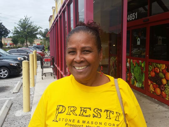 Voter Mayra Clemente, 60, registered as Non Party Affiliate. Clemente stands in front of Bravo Supermarkets in Poinciana, on the border of Polk and Osceola counties in Florida, where Organize Now was canvassing voters.