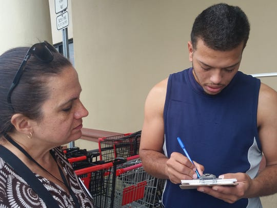 Voter Allanfredo Santos, 22, student, Democrat. Santos fills out a vote-by-mail ballot at Unidos Supermarket in Poinciana, on the border of Polk and Osceola counties in Florida.