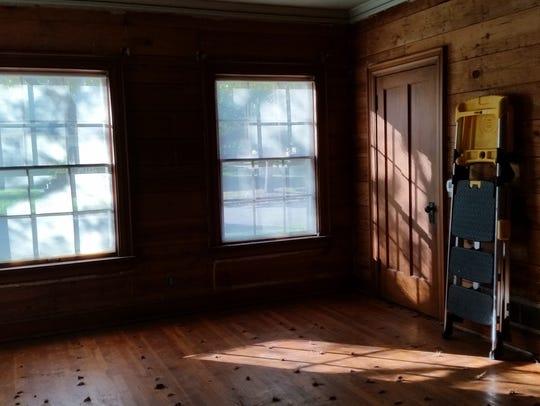 Shiplap and hardwood floors revealed.