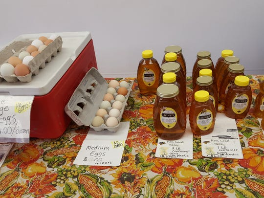 Honey and eggs from Treasure Hill Farm are displayed at The Homesteader Pantry in Marshfield Wednesday.