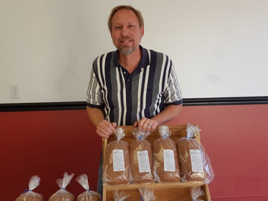 Gary Burich poses next to some bread he brought to The Homesteader Pantry on Wednesday in Marshfield.