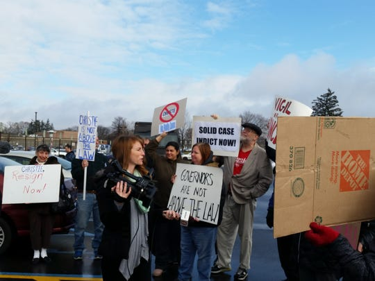 About a dozen protesters took part in the anti-Christie rally.