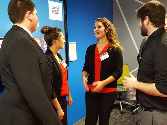 Katherine Zoromski (center right) talks with other students in The Branch's fall cohort at Northcentral Technical College in Wausau on Dec. 9, 2016.
