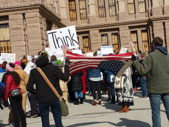 Protesters gather Monday outside the Texas Capitol