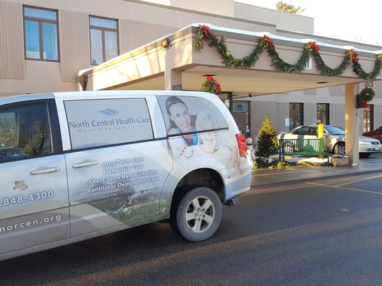A North Central Health Care van parked in front of the Mount View Care Center nursing home in Wausau on Tuesday.