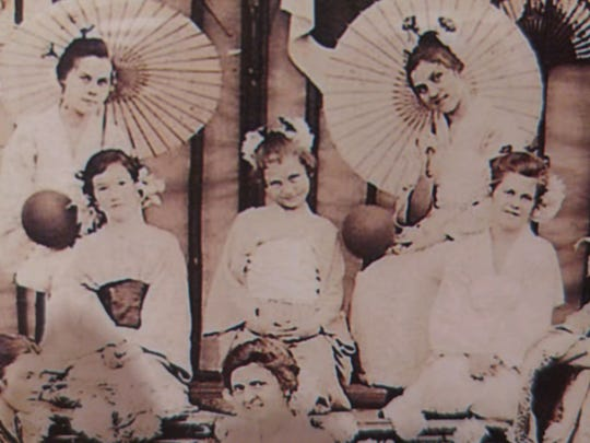Mary Woolslair, center,  is pictured in a Red Cross