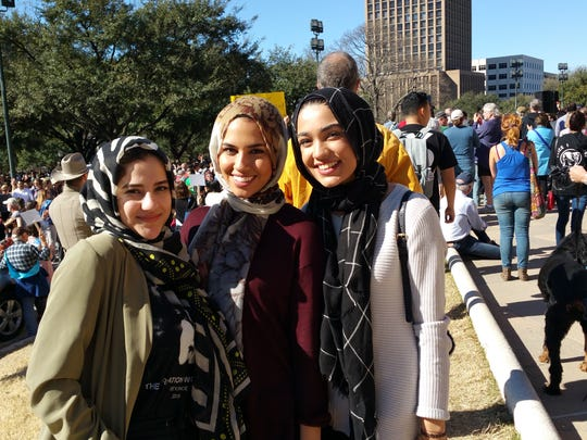 From left, Laila Basyouni, 17, Nada Shalaby, 16, and Iman Pahlavan, 15, participate in Texas Muslim Capitol Day in Austin after traveling from Houston.