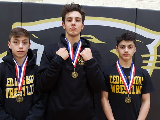 Dillon Jennings (center) is seen with teammates Antonio Cuffari (left) and Nick Coletta (right) at the 2017 Suburban Wrestling League County Championship in February.