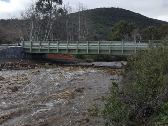 During a winter storm, the creek at Leo Carrillo State Park was flowing under a new freestanding bridge.