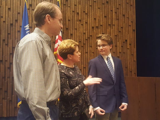 John Belton (right) talks with his parents Austin and Sharon Belton at the Young Entrepreneurs Academy investment panel event on March 21, 2017 at the Westwood Conference Center in Wausau.
