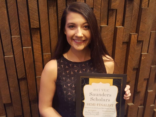 D.C. Everest Idea School senior Malia Oluszczyk poses for a photo after being selected as a Saunders Scholar in the Young Entrepreneurs Academy on March 21, 2017, at a conference center in Wausau.