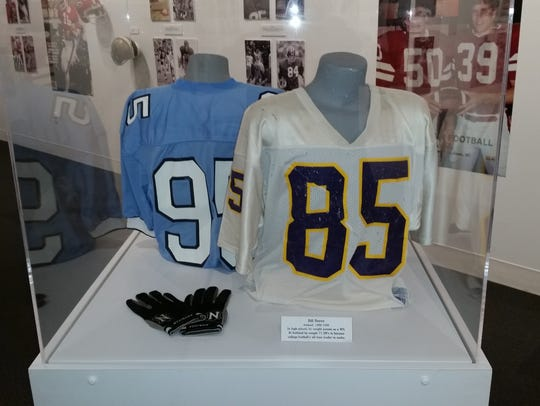 One of Bill Royce's No. 85 game jerseys hangs in a