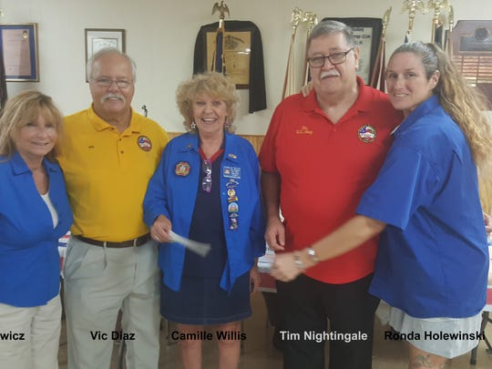 Check presentation to the Vietnam Veterans of Indian River County by the VFW Post 10210 Ladies Auxiliary: Kim Paskiewicz ( VFW Post 10210 Ladies Auxiliary), Vic Diaz ( VVIRC Secretary), Camille Willis (VFW Post 10210 Ladies Auxiliary), Tim Nightingale (VVIRC President), and Ronda Holewinski (VFW Post 10210 Ladies Auxiliary).