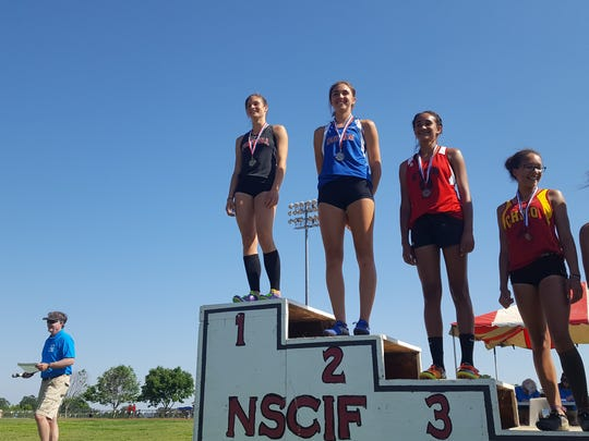 Foothill's Kira Porzio (left, top podium spot) poses after winning the pole vault at the Northern Section Championships on Friday at West Valley High School.