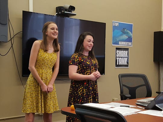 "McKenna Green (left) and Ashlyn Lewis pitch their business Lips Apocalypse to a ""Shark Tank"" of investors at D.C. Everest Junior High School on June 1, 2017."
