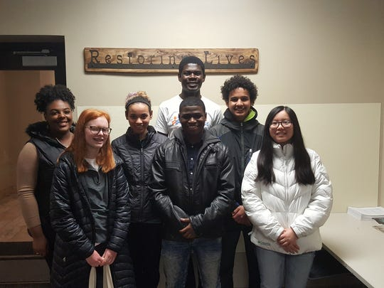 Oak Creek High School senior Nkazi Nchinda volunteers