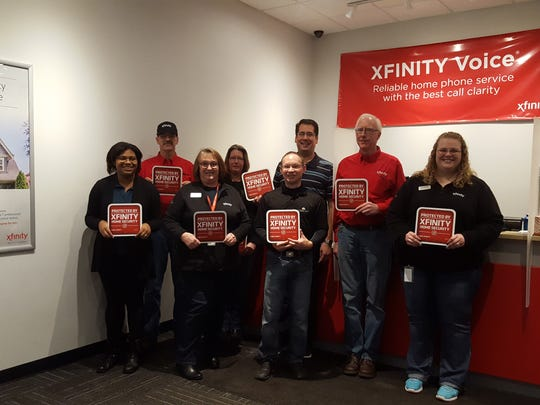 Comcast Manitowoc team members show their enthusiasm for Xfinity Home at the company's local Xfinity Store, 1614 Washington Ave.