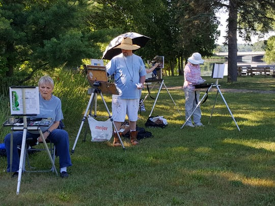 Members of Michigan Plein Art Painters gather on Saturday for outdoor sessions in Kensington Metropark.