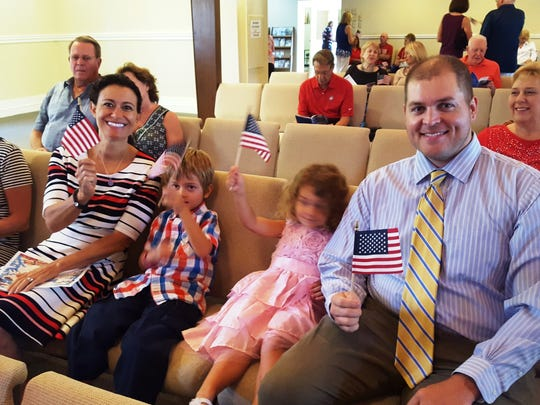 Visitors to Capri Christian Church get in the swing of the patriotic service by waving their miniature American Flags during the special patriotic service – Stars and Stripes Forever on Sunday, July 2.
