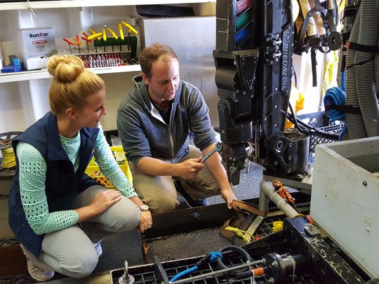 "Hercules Pilot Josh ""Bullseye"" Tetarenko shows Kaitlyn Lowen the Kraft Predator manipulator arm on Hercules."