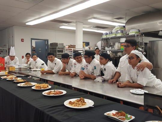 Guam Community College culinary arts students wait