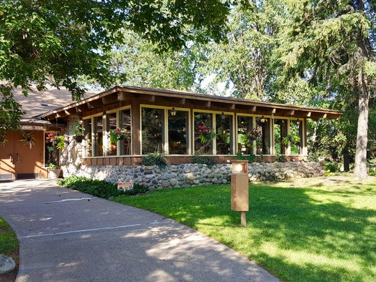 The Three Coins Restaurant at Holiday Acres Resort on Lake Thompson outside Rhinelander features a wall of windows for premium views of the surrounding woods.