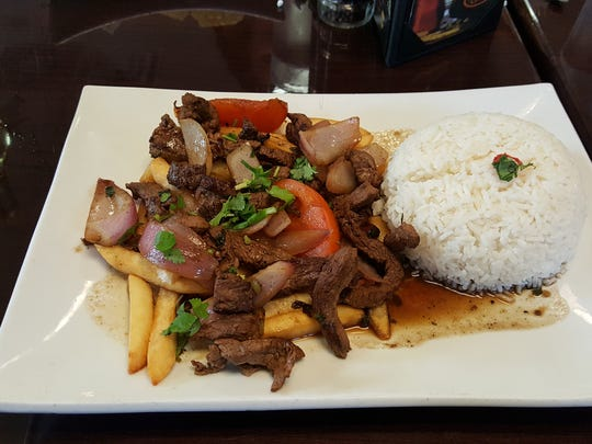 Lomo saltado (sauteed beef) at Aji Limon comes atop a bed of french fries and a side of rice.