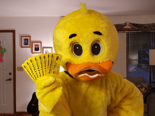 Cheese and Quackers 500 mascot, Chuck, is pictured with the raffle tickets that can be purchased to foster a rubber ducky.