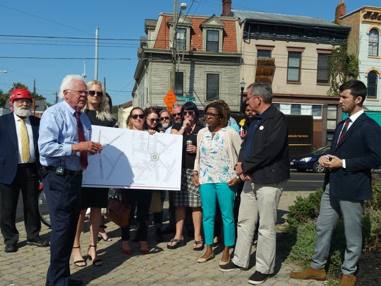 Vice Mayor David Mann, mayoral candidate Yvette Simpson, and Northside community leaders hold a press conference to call for a feasibility study to be conducted on a roundabout at the intersection of Knowlton's Corner in Northside.