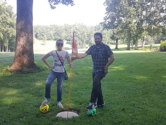 Spiro and Nicole Nicopoulos, the husband and wife team that makes up the band The Paper Crowns, enjoy a round of FootGolf at Jack's Mountain Preserve where they performed earlier this year.