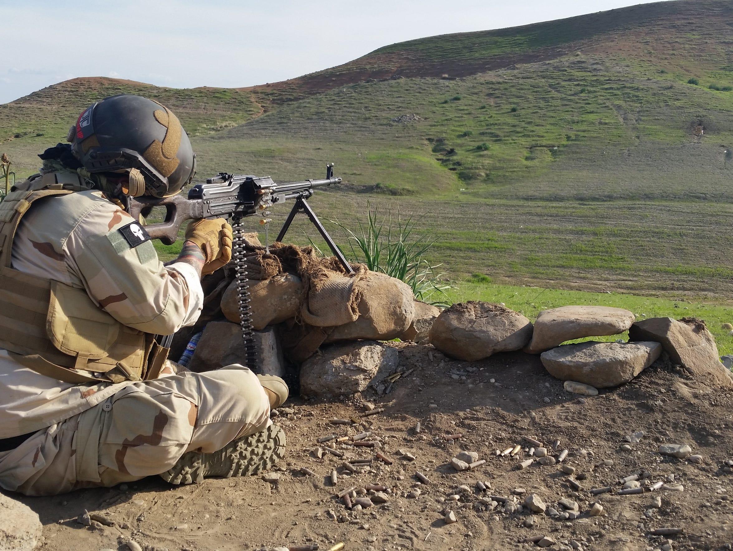 Anthony DelGatto trains in using his PKM machine gun