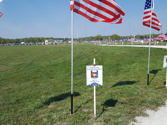 American flags and photos of Iowa's fallen service