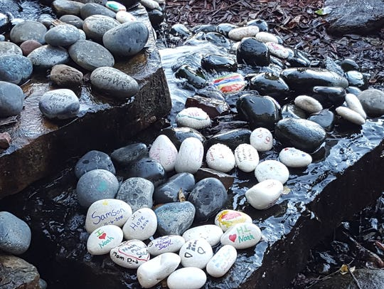 Children painted these stones in honor of their siblings
