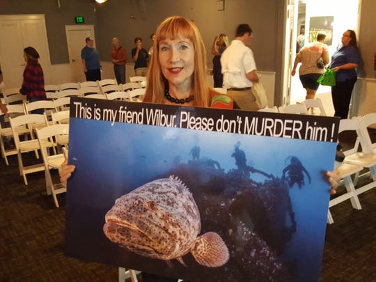 Suzanne Edwards, a diver who lives in Lake Worth, is a big fan of a Goliath grouper affectionately known as Wilbur which inhabits a reef off Boynton Beach. Edwards attended a public workshop Oct. 11 in Stuart.
