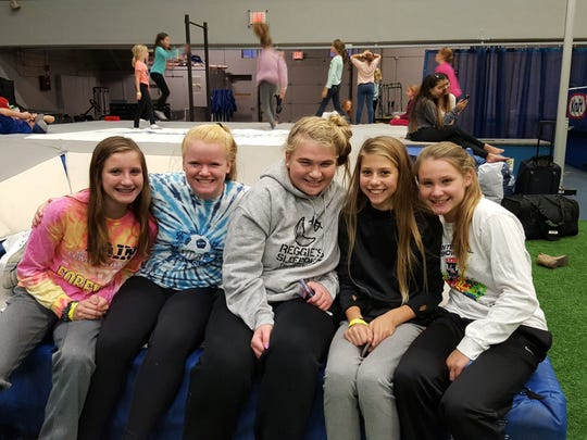 Youth Helping Youth, a Reggie's Sleepout team, takes shelter from the storm in Drake University's field house (from left to right): Julia Moore, 12; Sophia Ibach, 12; Anna Schaeffer, 13; Kathryn Gray, 12; Sarah Moore, 12 (not pictured: Grace Christian, 12, and Ally Anderson, 12). Saturday, October 21, 2017