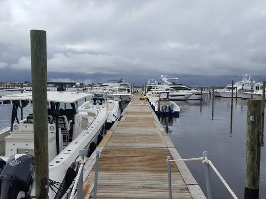 Before the rain. Stuart Boat Show setup was moving full speed ahead Tuesday as skies darkened on the horizon.