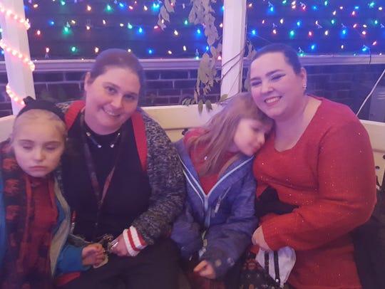Elizabeth, Laurel, Anastasia and Rachel Bowman-Cryer celebrate the holidays.