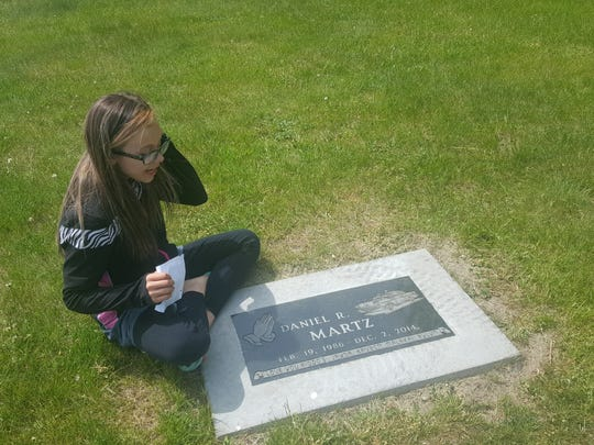Jayda Morrison, the oldest child of Daniel Martz, visits her father's grave often.