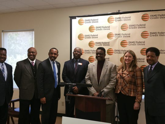 from left to right:  Sherwood Brown, FAMU Federal Credit Union, Al Latimer, director Office of Economic Vitality, Rep.  Ramon Alexander, Ernest Allen - President/CEP - FAMU Federal Credit Union, Michael Williams - Trustee/Board Member - FAMU Federal Credit Union, Cissy Proctor - executive director Florida Department of Economic Opportunity, Leon County Commissioner Bill Proctor