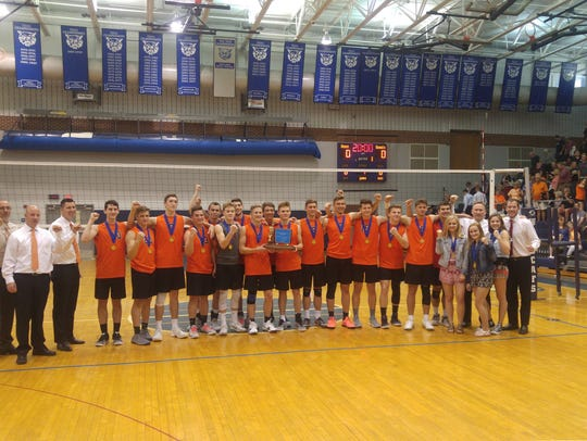 The Northeastern boys' volleyball team poses for a