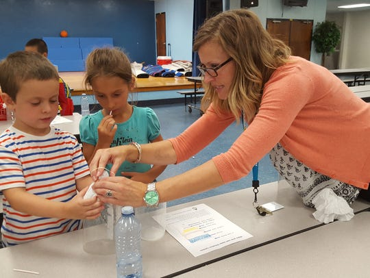 Jenny Tomes helps Lakewood Park Boys & Girls Club campers