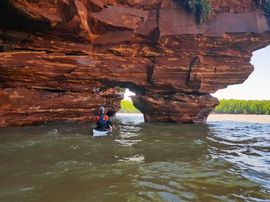 Jamiah Mahoney, a guide with Living Adventure, kayaks