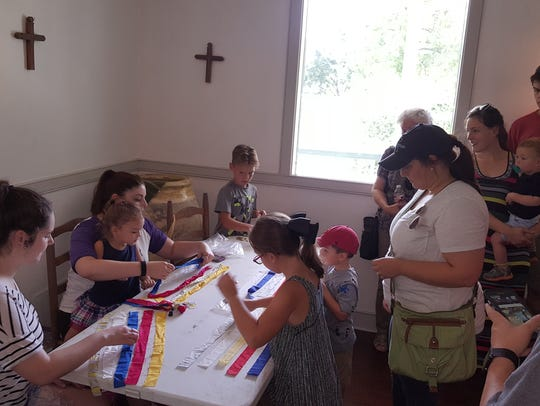 Children's crafts are among the activities at Acadian