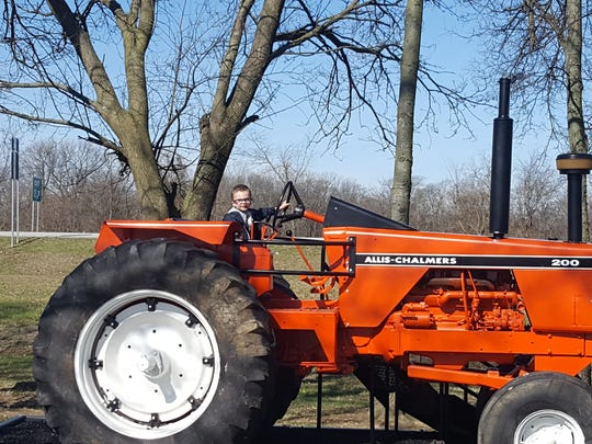 Restored tractor at Freedom Park gets plenty of use by local children.